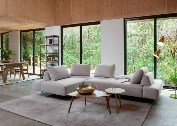 Airy and ready for some star treatment, the Divan sofa stuns in the centre of this airy, bright space.