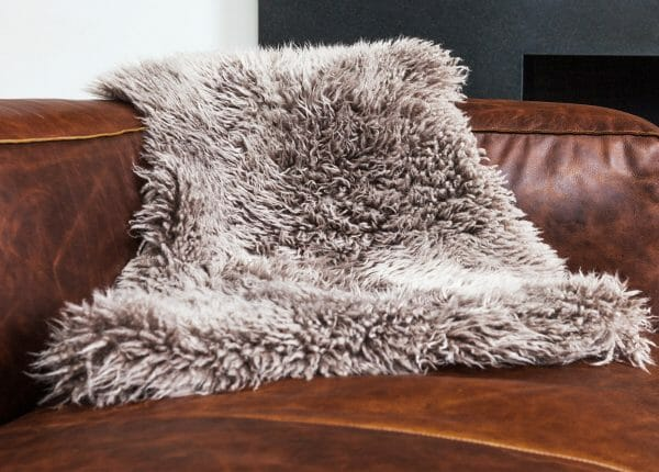 Ultimate Furniture Cleaning Guide: Our Lanna sheepskins are the perfect place to take a long winter's nap. Dry clean only, please!
