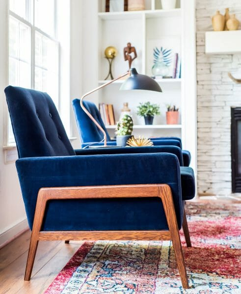 The Nord chair in blue velvet brings a fresh burst of color to a cool, neutral space.