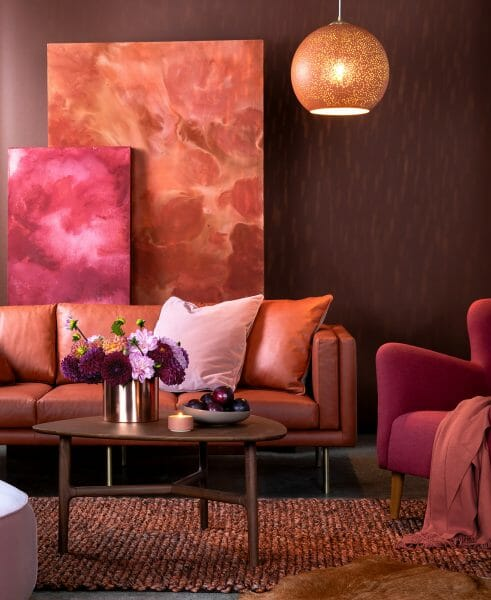 Reds and pinks (like the Belez sofa in Terra Red and the Lucca pillow set in Pink) set a cheerful, yet sultry mood.