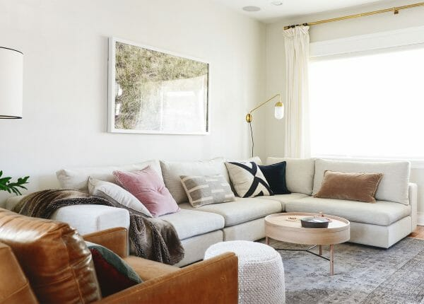 The YellowBrickHome family cuddles up on our Gaba modular sofa in Pearl.