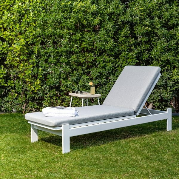 Pour a drink and lean back into the Eleya lounger. Just don't forget to apply plenty of SPF.