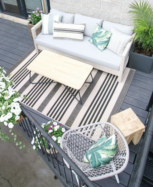 The windy city's annual precipitation is just shy of Seattle's, but come in deluges rather than spits. That didn't stop The DIYPlaybook's Casey Finn from building a beautiful outdoor living space. She uses the solid teak, water resilient Arca sofa to tie her patio together.