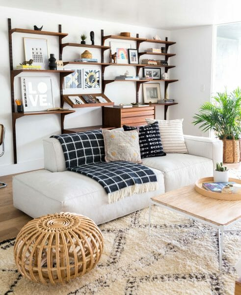 For big house comfort in a small apartment, the Solae sofa lays low, making your room feel bigger. Bonus: it's modular. You can add and remove seats to create the perfect fit. We love how Veneer Designs has layered hers with textural blankets and pillows.