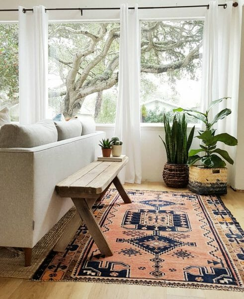 We love how the family over at Kismet house has separated their entrance from their sitting room with two rugs and some clever furniture blocking. The clean-lined Burrard makes a great canvas for the rustic bench.
