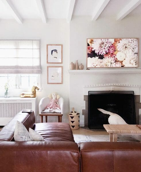 We love how the low profile Mello sectional sofa makes the fireplace feel cozy and intimate without closing the room off. Another treasure from the Wit and Delight trove.