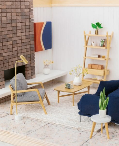 Teeny-tiny. We commissioned Mandi to make a replica of our Small Spaces set — and boy, did she deliver! Pictured here are the Denman chair, Abisko sofa, Brezza coffee table, Lignum shelf, and Crane floor lamp.