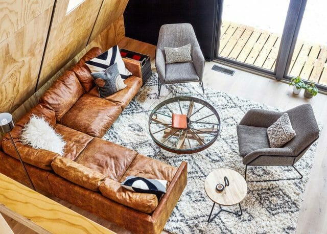An Article leather sectional in the Lokal Hotel's A-frame cabin