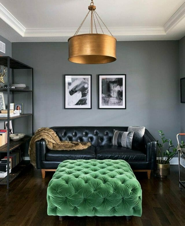 Article's black Alcott Leather sofa in a living room with a green emerald velvet pouf