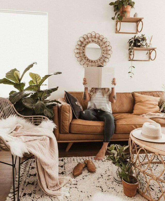 Blogger Shyla Cino sits on Article leather sofa