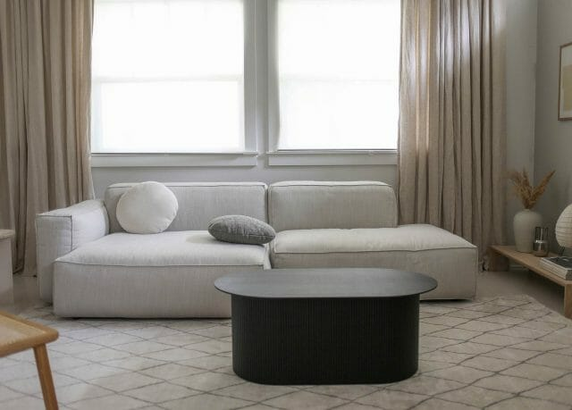 A Merry Mishap shares her white Article Solae sofa in a serene living room.