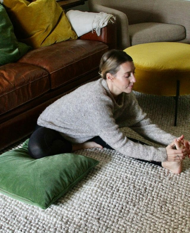 Ally Maz stretches on her Article Lucca pillows.