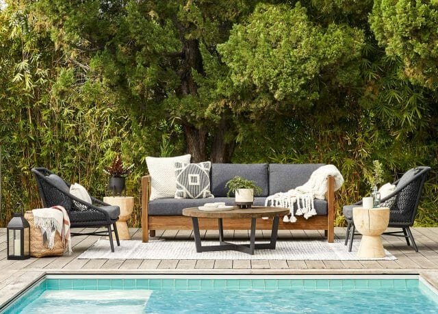 Various pieces of Article's outdoor furniture collection sits poolside.