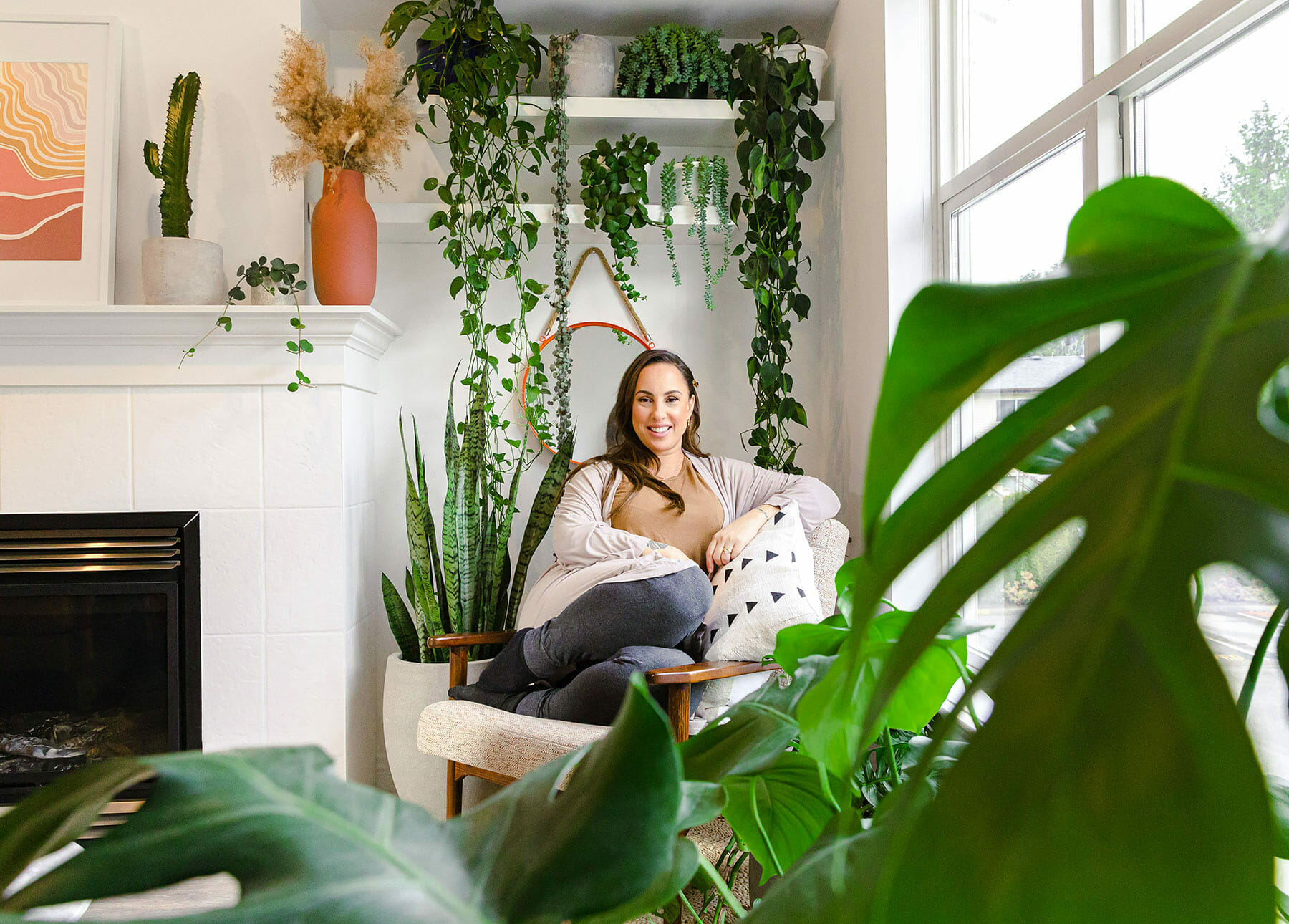 Plant designer Izabela Jankus in her home, surrounded by plants.
