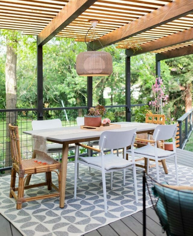 Studio Plumb's patio makeover includes the Alta Dining Table and Elan chair.