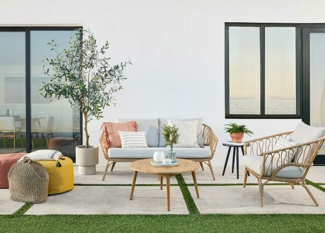 The Lucara sofa set features synthetic wicker.