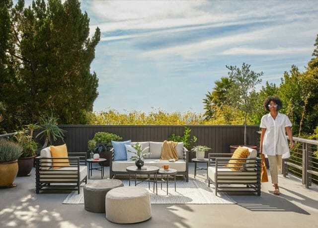 The Kopelin Sofa sits on a tranquil deck.
