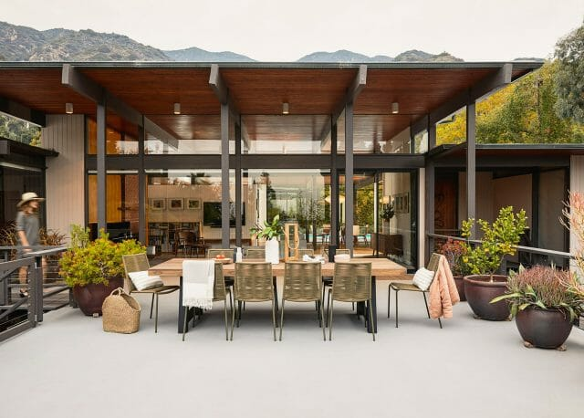 An outdoor dining set is shown on a beautiful, large patio.