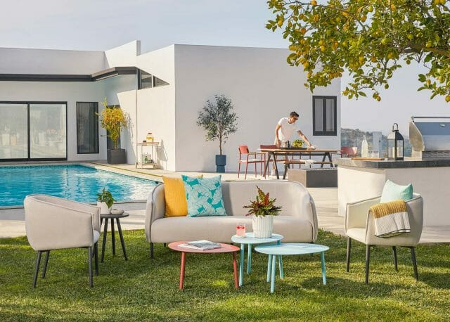 Article's Venn Sofa and Lounge Chairs are arranged next to a pool.