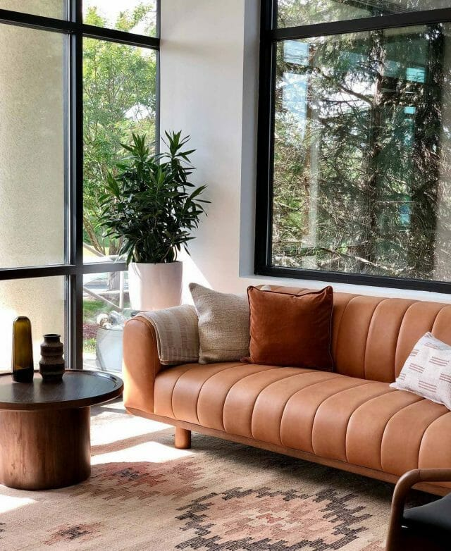 Article's Brown Texada Sofa in a living room with big windows and plants.