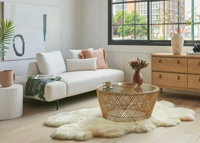 A white sofa features colorful throws and pillows