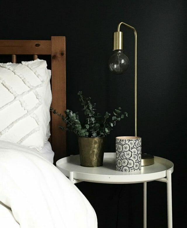 Julie Pierp's bedside table is shown with an Article Beacon Table Lamp
