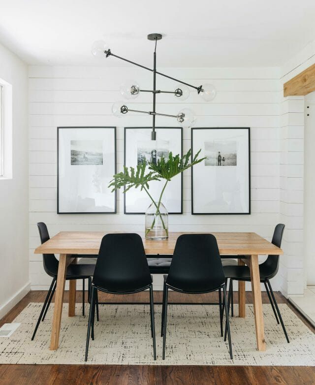 A dining room features black Svelti Dining Chairs and a wooden dining table