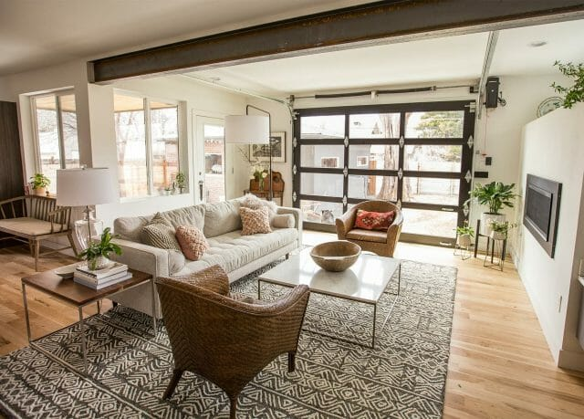 Blogger Flax and Twine's living room features a large patterned rug and a glass garage door window.
