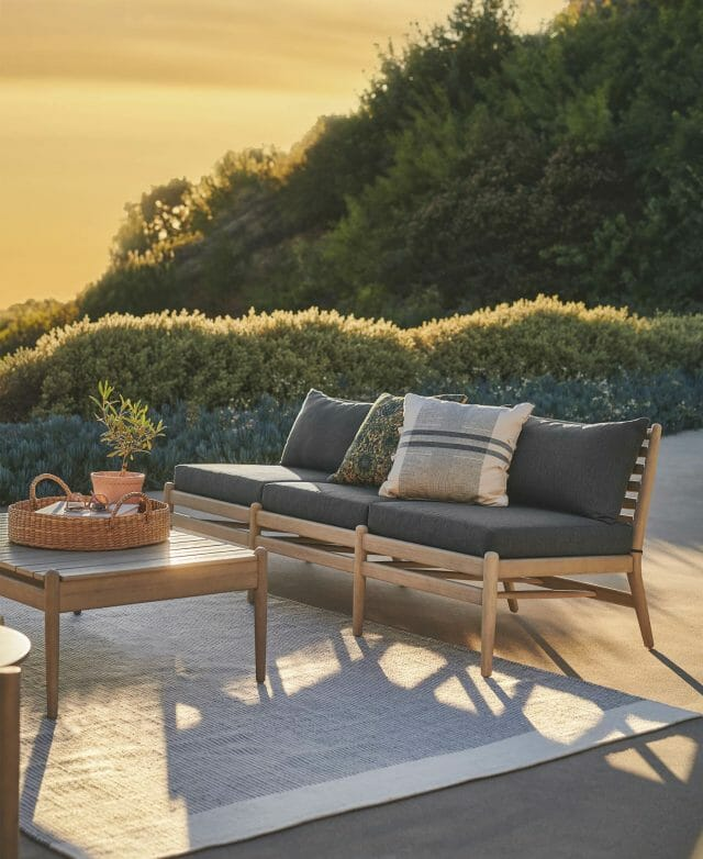 Article's Lagora Sofa sits in front of bushes as the sun shines.
