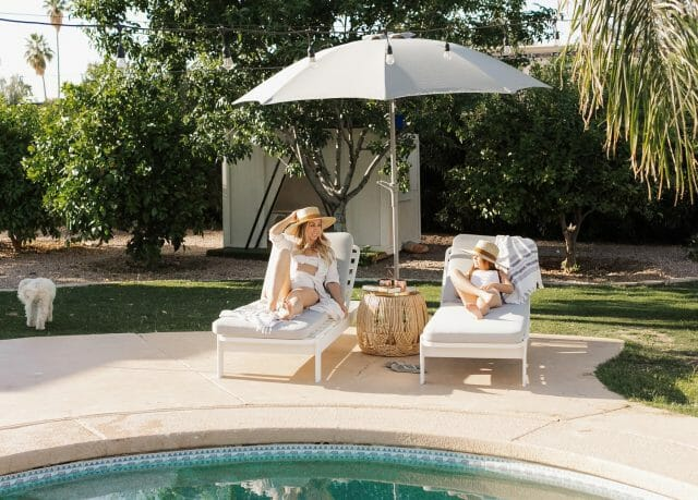 Paige of Love Designed Life relaxes on an Eleya Lounge Chair with her daughter