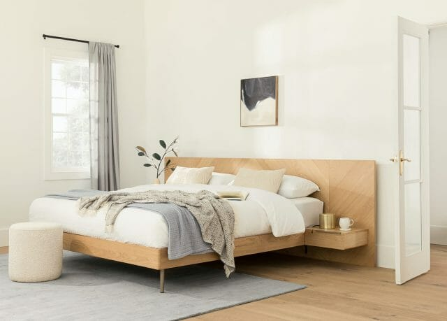 The Nera bed in a white, airy room.